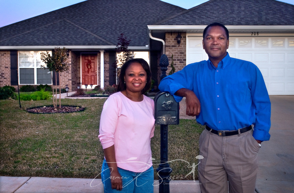 Veda and Levern Eady stand outside their home in Madison, Ala. Oct. 27, 2009. The Eadys chose to relocate to the Huntsville metropolitan area for the intellectually-rich environment it provides for their children as well as its future economic potential. Analysts expect Huntsville to fare well in the new economy thanks to its strong aerospace, defense, and biotech industries. (Photo by Carmen K. Sisson/Cloudybright)