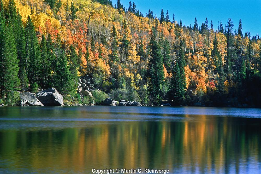 Autumn reflections in Bear Lake.  Rocky Mountain National Park.  Colorado, USA