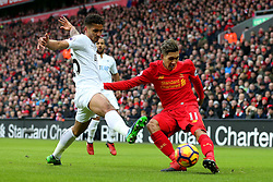 Roberto Firmino of Liverpool crosses under pressure from  Kyle Naughton of Swansea City - Mandatory by-line: Matt McNulty/JMP - 21/01/2017 - FOOTBALL - Anfield - Liverpool, England - Liverpool v Swansea City - Premier League