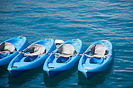Four blue canoes floating in Avalon bay. Catalina Island, CA 9.20.14