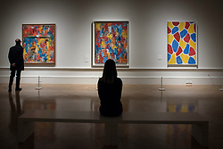 """© Licensed to London News Pictures. 19/09/2017. London, UK. Visitors views (L to R) """"Painting With Two Balls"""", 1960, """"False Start"""", 1959, and """"Nines"""", 2006, all by Jasper Johns.  Preview of a landmark exhibition by Jasper Johns RA called """"Something Resembling Truth"""" at the Royal Academy of Arts in Piccadilly.  Sculptures, drawing, prints plus new works are on display 25 September to 10 December 2017.   Photo credit : Stephen Chung/LNP"""