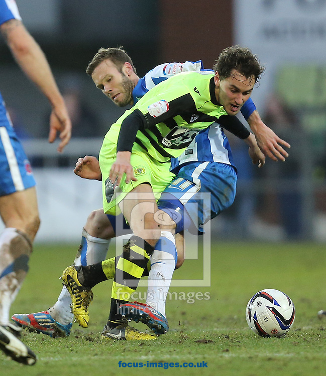 Picture by Paul Gaythorpe/Focus Images Ltd +447771 871632.09/03/2013.Andy Monkhouse of Hartlepool United and Ed Upson of Yeovil Town during the npower League 1 match at Victoria Park, Hartlepool.