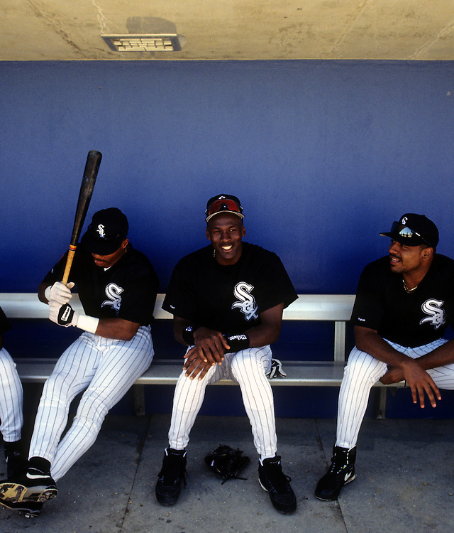 SARASOTA, FL-MARCH 1994:  NBA Hall of Famer Michael Jordan sits with teammates in the dugout prior to his first professional game as a member of the Chicago White Sox during spring training in Sarasota, Florida in March 1994.  (Photo by Ron Vesely)