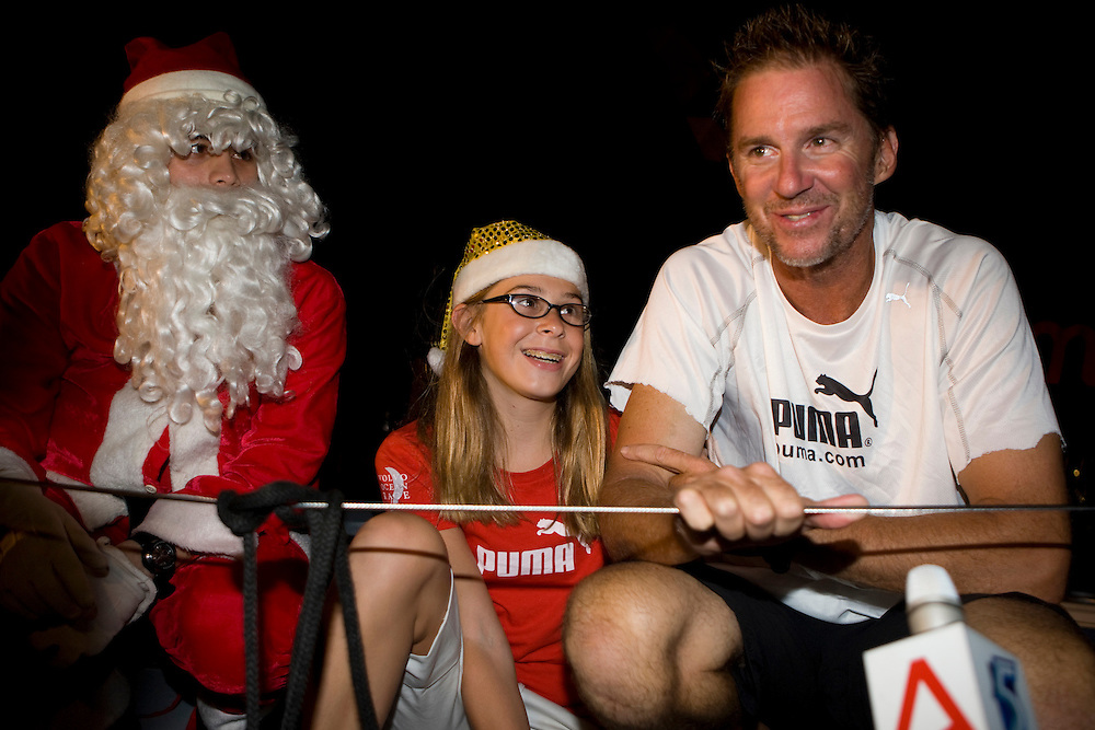22DEC08. PUMA Ocean Racing dock in Singapore after cross the finish line at 23:08:01 local (15:08:01GMT), to finish leg 3 in 2nd place. .Ken Read and his daughter Tory with Father Christmas!