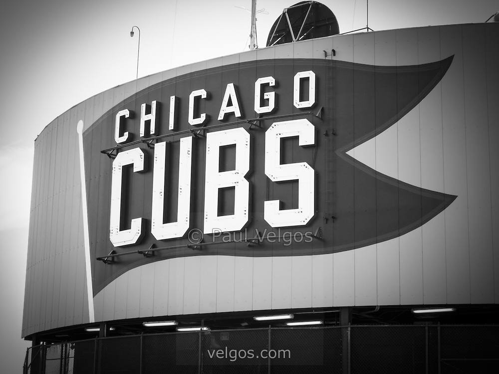 Chicago Cubs Wrigley Field sign black and white picture. Wrigley Field is a Chicago landmark baseball field that was built in 1914 and is home to the Chicago Cubs Major League Baseball team.  Photo Copyright © 2012 Paul Velgos with All Rights Reserved.