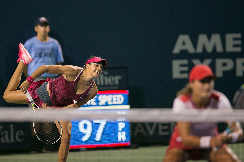 August 22, 2014, New Haven, CT:<br /> Caroline Garcia serves alongside Monica Niculescu during the women's doubles semi-finals against Marina Erakovic and Arantxa Parra Santonja on day eight of the 2014 Connecticut Open at the Yale University Tennis Center in New Haven, Connecticut Friday, August 22, 2014.<br /> (Photo by Billie Weiss/Connecticut Open)