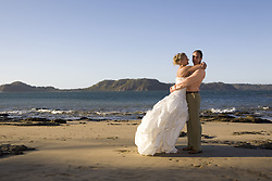 July 21, 2019 - Bride And Groom Embracing On Beach (Credit Image: © Caley Tse/Design Pics via ZUMA Wire)