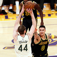30 March 2018: Milwaukee Bucks center Tyler Zeller (44) takes a jump shot over Los Angeles Lakers forward Kyle Kuzma (0) during the Milwaukee Bucks 124-122 victory over the LA Lakers, at the Staples Center, Los Angeles, California, USA.