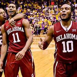 Jan 30, 2016; Baton Rouge, LA, USA; Oklahoma Sooners guard Isaiah Cousins (11) celebrates after a game winning basket with teammates guard Jordan Woodard (10) and guard Dinjiyl Walker (2) during the second half of a game at the Pete Maravich Assembly Center. Oklahoma defeated LSU 77-75. Mandatory Credit: Derick E. Hingle-USA TODAY Sports