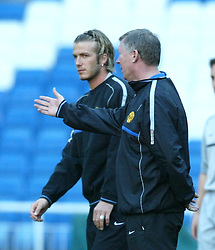 MADRID, SPAIN - Monday, April 7, 2003: Manchester United's David Beckham (l) and manager Alex Ferguson training at the Santiago Bernabeau ahead of their side's Champions League Quarter Final 1st Leg match with Real Madrid. (Pic by David Rawcliffe/Propaganda)