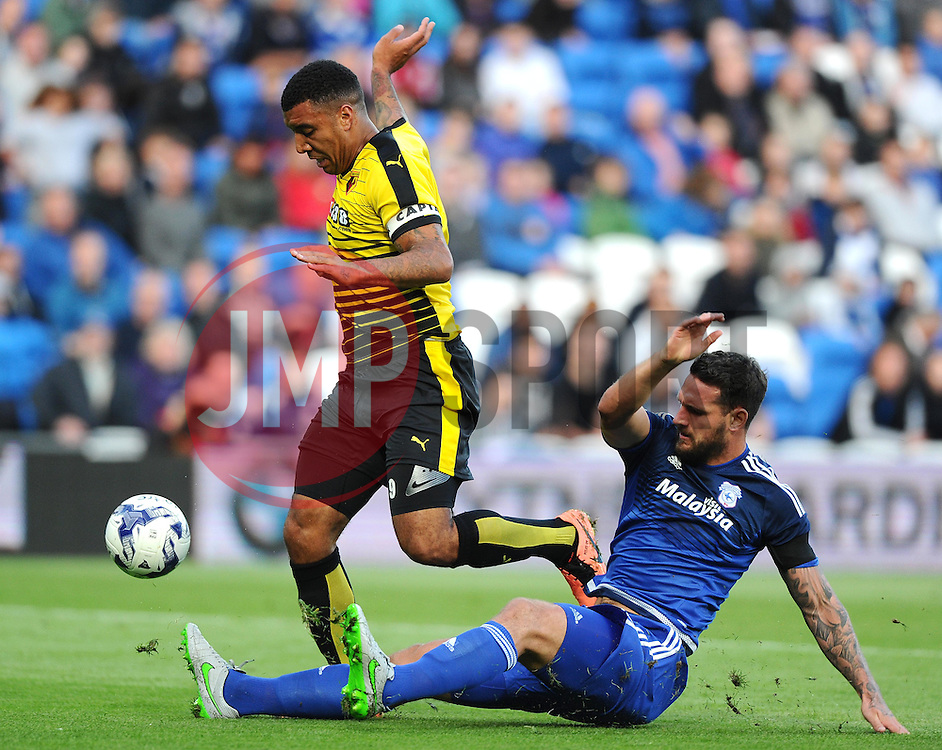 Sean Morrison of Cardiff City tackles Troy Deeney of Watford to deny a goal scoring opportunity  - Mandatory by-line: Joe Meredith/JMP - 07966386802 - 28/07/2015 - SPORT - FOOTBALL - Cardiff,Wales - Cardiff City Stadium - Cardiff City v Watford - Pre-Season Friendly
