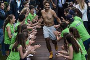 April 24, 2016 - Barcelona, Catalonia, Spain - <br /> <br /> RAFAEL NADAL of Spain runs a gauntlet of ball boys and girls before jumping into the club's swimming pool after winning the Men's Singles Final of the Barcelona Open tennis tournament. Nadal won 6:4, 7:5.<br /> ©Exclusivepix Media