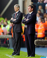 Photo: Leigh Quinnell.<br /> West Bromwich Albion v Arsenal. The Barclays Premiership.<br /> 15/10/2005. Arsenal manager Arsene Wenger and West Brom manager Bryan Robson adopt the same pose.