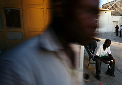 An African immigrant eats his meal during Eid al-Fitr celebrations to mark the end of Ramadan at the Marsa Open Centre for Refugees and Asylum Seekers in Marsa in Valletta's Grand Harbour September 10, 2010.  The centre houses around 1000 immigrants, most of whom are Muslim, according to the centre's management.  Many would-be immigrants who were rescued by the Maltese Armed Forces while attempting to reach European soil from Africa end up living in the converted school after spending up to 18 months in detention.