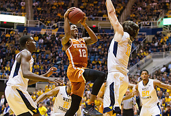 Feb 20, 2017; Morgantown, WV, USA; Texas Longhorns guard Kerwin Roach Jr. (12) drives down the lane and shoots during the first half against the West Virginia Mountaineers at WVU Coliseum. Mandatory Credit: Ben Queen-USA TODAY Sports
