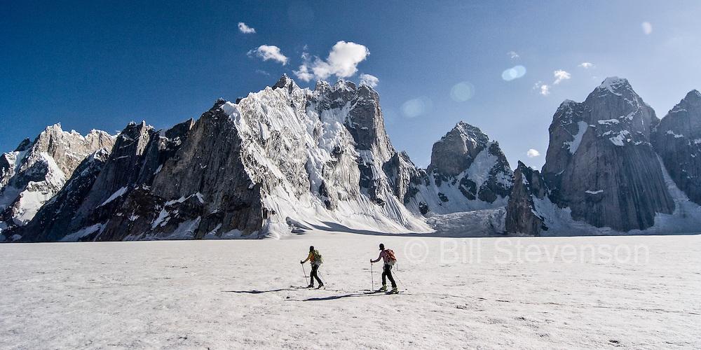Two women skiing on the Biafo glacier in the Karakoram himalaya in Pakistan
