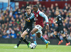 BIRMINGHAM, ENGLAND - Easter Sunday, March 31, 2013: Liverpool's Jordan Henderson in action against Aston Villa's Charles N'Zogbia during the Premiership match at Villa Park. (Pic by David Rawcliffe/Propaganda)