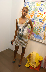Model TOLULA ADEYEMI at a private view of artist Damian Elwes work 'Artists Studios' held at Scream, 34 Bruton Street, London W1 on 29th June 2006.<br /><br />NON EXCLUSIVE - WORLD RIGHTS