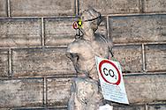 """Roma 5 Giugno 2008.  <br /> L' Associazione ambientalista  """"Terra""""  per protesta contro l'emissione di CO2, ha applicato  su 150 statue di Roma  mascherine antinquinamento e cartelli contro il CO2.<br /> La statua di Pasquino<br /> Rome June 5, 2008.  <br /> L 'Environmental association """"Earth"""" in protest against the emission of CO2, has applied to 150 statues of Rome anti-pollution masks and poster against the CO2."""