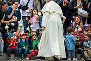 Pope Francis greets a groups the children of the nursery school of Biocampus Medico in Trigoria, Rome, at the end of his weekly general audience in St. Peter's Square at the Vatican on May 23, 2018.