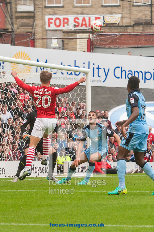 Tom Bradshaw of Barnsley heads home his sides third goal during the Sky Bet Championship match at Oakwell, Barnsley<br /> Picture by Matt Wilkinson/Focus Images Ltd 07814 960751<br /> 27/08/2016