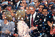 U.S President Bill Clinton with First Lady Hillary Rodham Clinton celebrate as confetti falls after they accepted the nomination for the democrat party at the 1996 Democratic National Convention August 29, 1996 in Chicago, IL.