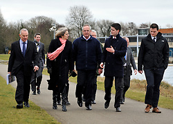 © Licensed to London News Pictures. 27/02/2012, Windsor, UK. (L-R ) JOHN TURNBULL of Olympic Security Co-Ordinator for Thames Valley Police. THERESA MAY, IVOR LLOYD Managing Director of Dorney Lake, JOHN KELLY, Venue Operations Manager London 2012, JOSS CARTER Venue Security Manager 2012 walk along the course for Olympic Rowing evens. Home Secretary Theresa May visits Eton College Rowing Centre in Windsor today 27 february 2012 to see the preparations being made ahead of the London Olympic and Paralympic Games. Photo credit : Stephen Simpson/LNP