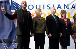1st January, 2006. New Year's Day in New Orleans, Louisiana. Louisiana Rebirth interfaith service at the Superdome rings out the old disasterous 2005 and rings in what politicians and locals hope will be a successful 2006. Politicians (from left) Mayor Ray Nagin, US Senator Mary Landrieu, Lieutenant Govenor Micth Landrieu and Govenor Kathleen Blanco give praise for a better year with religious leaders.