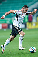 Legia's Marek Saganowski controls the ball during T-Mobile ExtraLeague soccer match between Legia Warsaw and Wisla Krakow in Warsaw, Poland.<br /> <br /> Poland, Warsaw, March 15, 2015<br /> <br /> Picture also available in RAW (NEF) or TIFF format on special request.<br /> <br /> For editorial use only. Any commercial or promotional use requires permission.<br /> <br /> Mandatory credit:<br /> Photo by © Adam Nurkiewicz / Mediasport