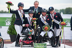 British Team Gold Medal Winners from left to right:<br /> Sophie Wells, Sophie Christiansen, Lee Pearson, Natasha Baker<br />   Podium for  Team Para-dressage at the 2014 World Equestrian Games, Caen, Normandy, France..