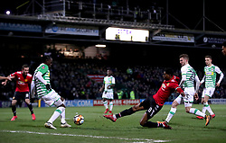 Manchester United's Marcus Rashford (third right) in action during the Emirates FA Cup, fourth round match at Huish Park, Yeovil.