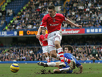 Photo: Lee Earle.<br /> Chelsea v Charlton Athletic. The Barclays Premiership. 22/01/2006. Chelsea's Joe Cole slides in on Darren Ambrose.
