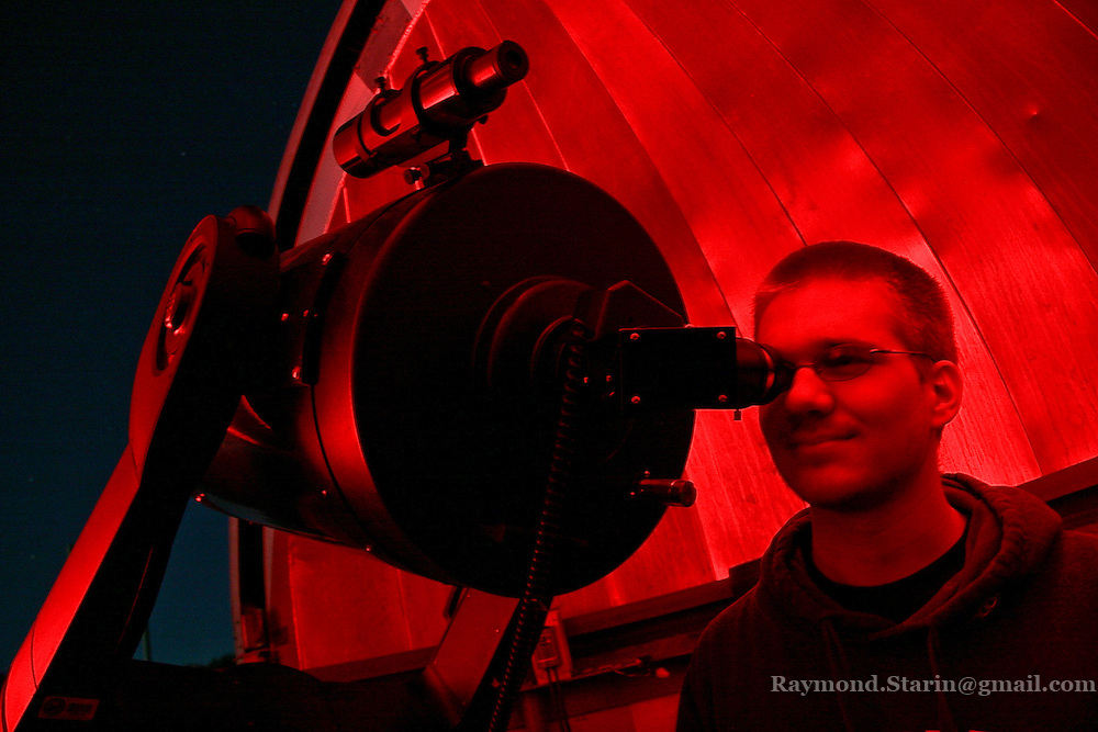 Observatory lab assistant and junior astronomy major Aaron Kingery gazes at Jupiter from Minnesota State's Standeford Observatory during the open house.