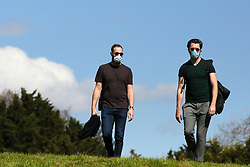 © Licensed to London News Pictures. 04/04/2020. London, UK. Men wearing face masks in Finsbury Park, north London on a warm and sunny day, during coronavirus lockdown. According to the Met Office, temperature in London is likely to reach 20 degrees this weekend. The Government has ordered that people go out only for food and health reasons or for work, and keep 2 meters away from other people at all times to slow the spread of the virus and reduce pressure on the NHS. Photo credit: Dinendra Haria/LNP