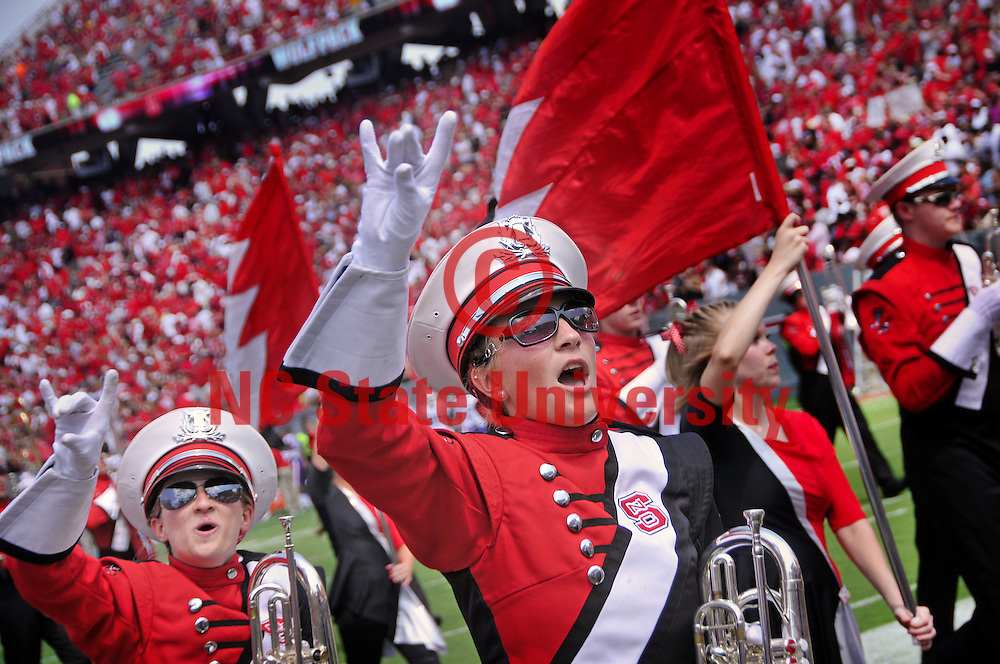 Marching band members howl as they leave the field.