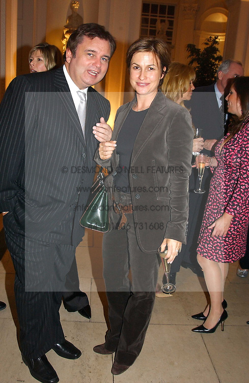 EAMON HOLMES and EMMA FORBES at a party hosted by Bentley motorcars held at The Orangery, Kensington Palace, London on 3rd November 2004.<br />