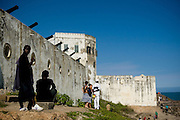 Visitors hang out near Cape Coast castle in Cape Coast, Ghana on Saturday September 6, 2008. The fort was used during the slave trade as one of several exit points for slaves leaving Africa for the New World.