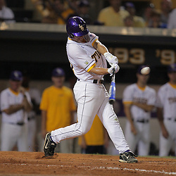 09 June 2008:  Ryan Schimpf #16 connects on a 2-run home run in the bottom of the seventh inning for LSU against UC Irvine. The LSU Tigers advanced to the College World Series with a 21-7 victory over the UC Irvine Anteaters in game three of the NCAA Baseball Baton Rouge Super Regional Alex Box Stadium in Baton Rouge, LA..