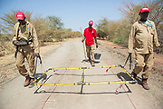 Pictured is an UNMAS team conducting route assessment clearance on the Pariang-Panakuach Road north of Bentiu, using a large loop metal detector.<br />