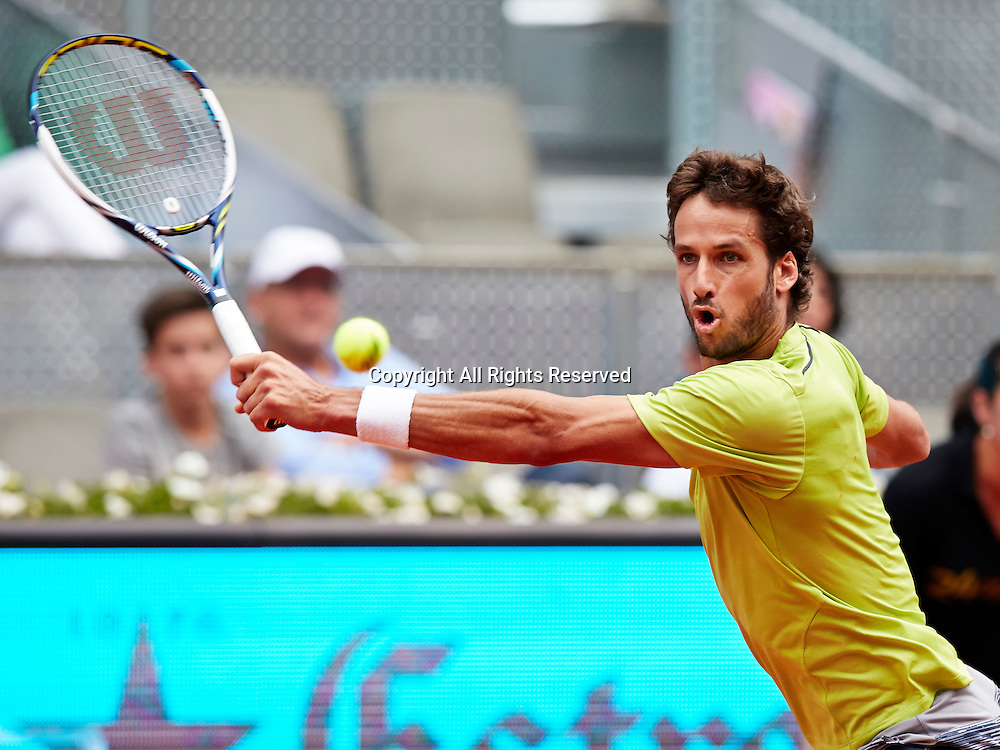 07.05.2014 Madrid, Spain. Feliciano Lopez of Spain plays a backhand during the game with Mikhail Youzhny of Rusia on day 4 of the Madrid Open from La Caja Magica.