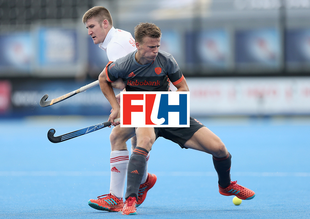 LONDON, ENGLAND - JUNE 24: Thijs van Dam of the Netherlands and Liam Sanford of England battle for possession during the semi-final match between England and the Netherlands on day eight of the Hero Hockey World League Semi-Final at Lee Valley Hockey and Tennis Centre on June 24, 2017 in London, England.  (Photo by Alex Morton/Getty Images)