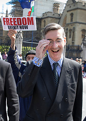 © Licensed to London News Pictures. 15/05/2019. London, UK. Conservative MP Jacob Rees Mogg is surrounded by protestors as he leaves Parliament after attending Prime Minister's Question's. Photo credit: Peter Macdiarmid/LNP