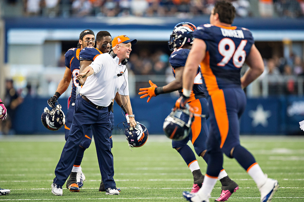 ARLINGTON, TX - OCTOBER 6:  Head Coach John Fox of the Denver Broncos congratulates his team after a score against the Dallas Cowboys at AT&T Stadium on October 6, 2013 in Arlington, Texas.  The Broncos defeated the Cowboys 51-48.  (Photo by Wesley Hitt/Getty Images) *** Local Caption *** John Fox