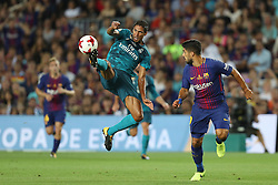 August 13, 2017 - Barcelona, Spain - Raphael Varane of Real Madrid controls the ball under pressure from Luis Suarez of FC Barcelona during the Spanish Super Cup football match between FC Barcelona and Real Madrid on August 13, 2017 at Camp Nou stadium in Barcelona, Spain. (Credit Image: © Manuel Blondeau via ZUMA Wire)