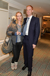 VISCOUNT LYMINGTON and ARABELLA NOORTMAN at the launch of Mrs Alice in Her Palace - a fashion retail website, held at Fortnum & Mason, Piccadilly, London on 27th March 2014.