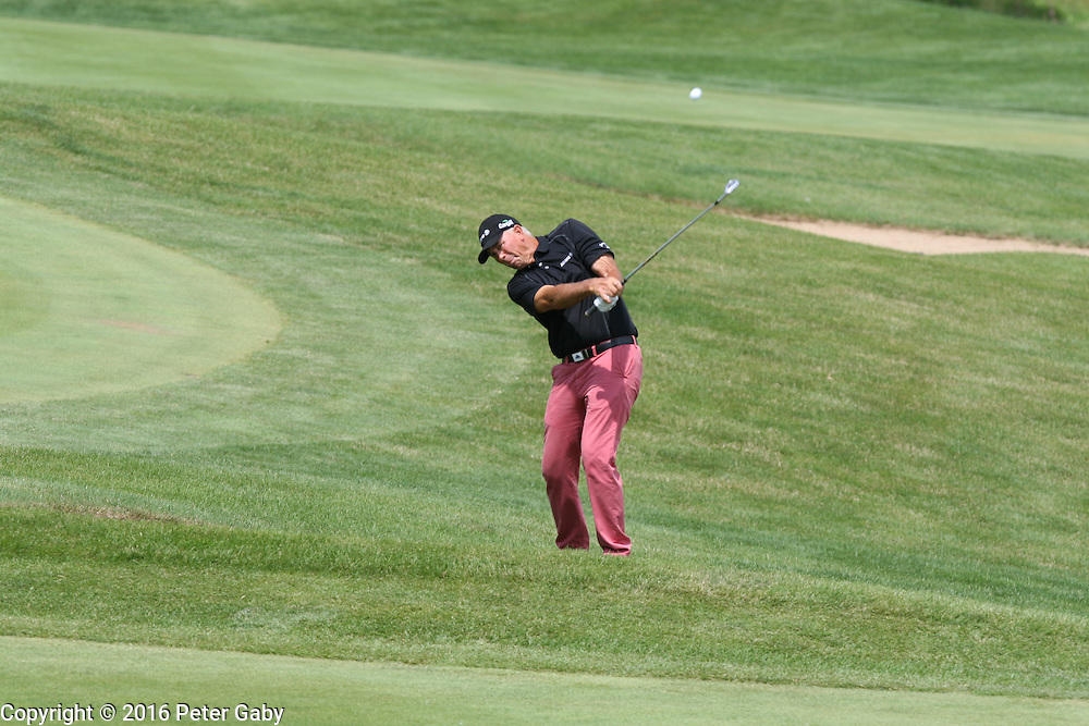 Tom Lehman hitting his second shot on the 18th fairway at the 2016 American Family Championship held at University Ridge Golf Course, Madison,  WI. on June 24, 2016.<br /> <br /> <br /> <br /> <br /> <br />  2016 American Family Championship held at University Ridge Golf Course, Madison,  WI. on June 23, 2016.