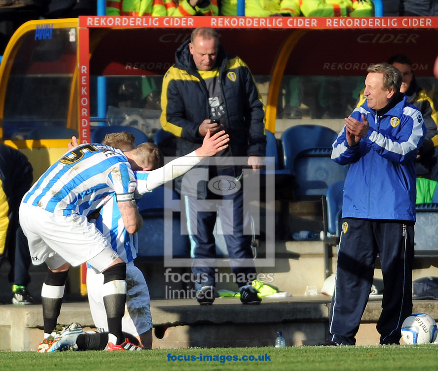 Picture by Graham Crowther/Focus Images Ltd +44 7763 140036.01/12/2012.Adam Clayton of Huddersfield Town celebrates his penalty goal in front of Neil Warnock manager of Leeds United during the npower Championship match at the John Smiths Stadium, Huddersfield.