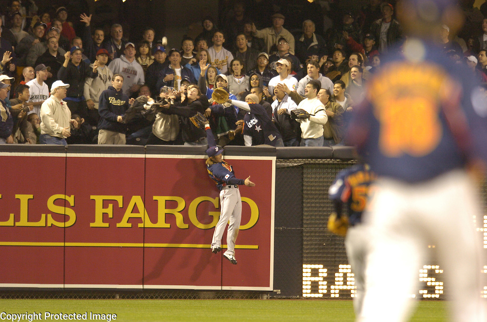 Team Japan's Hitoshi Tamura tries to catch Team Cuba's Eduardo Paret's home run in the 1st inning in Final action of the World Baseball Classic at PETCO Park, San Diego, CA.
