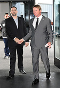 Jan 9, 2018; Alameda, CA, USA; Jon Gruden (right) shakes hands with Vittorio DeBartolo at press conference to introduce Gruden as head coach at the Raiders headquarters.
