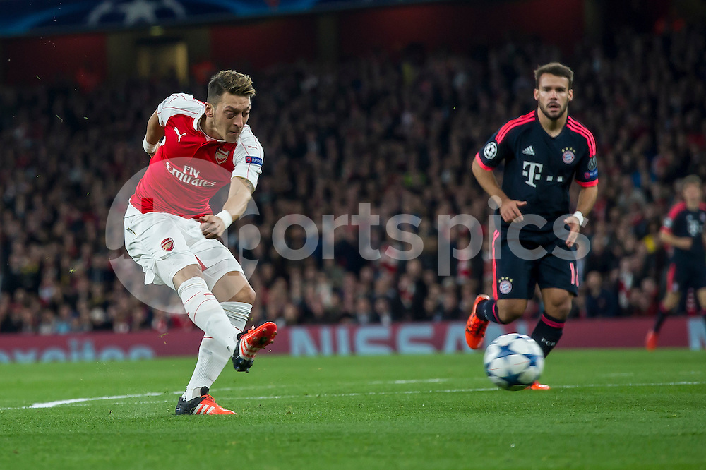 Mesut Özil of Arsenal takes a shot at goal during the UEFA Champions League Group F match between Arsenal and Bayern Munich at the Emirates Stadium, London, England on 20 October 2015. Photo by Salvio Calabrese.